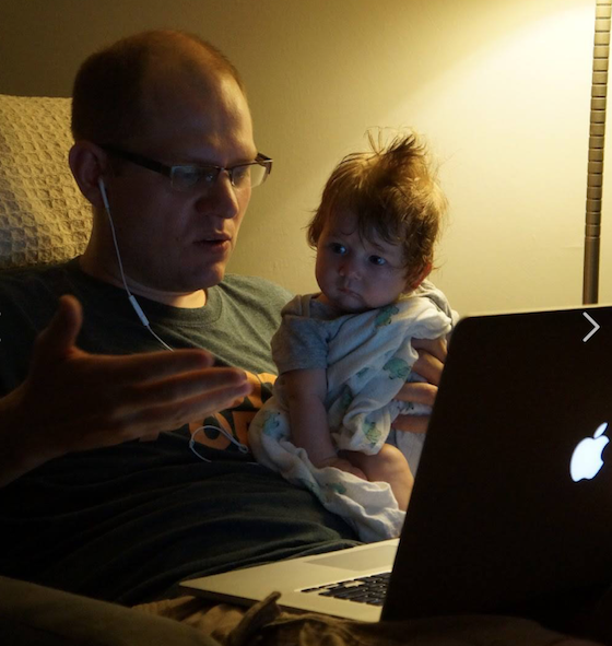 Jeff and baby daughter Rowan working on Book Riot together